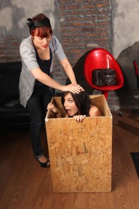 Emma Glover in a box